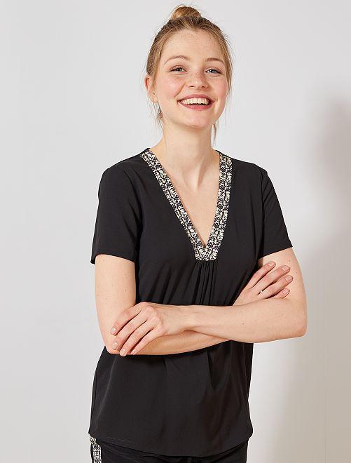 Blusa vaporosa con escote de pitón                             negro