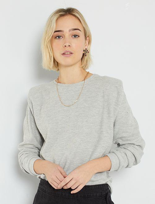 Camiseta gruesa con hombreras                                                     GRIS