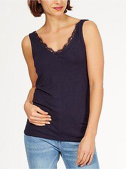 Mujer Camiseta sin mangas de punto vaporoso y elástico con escote de pico con borde de encaje