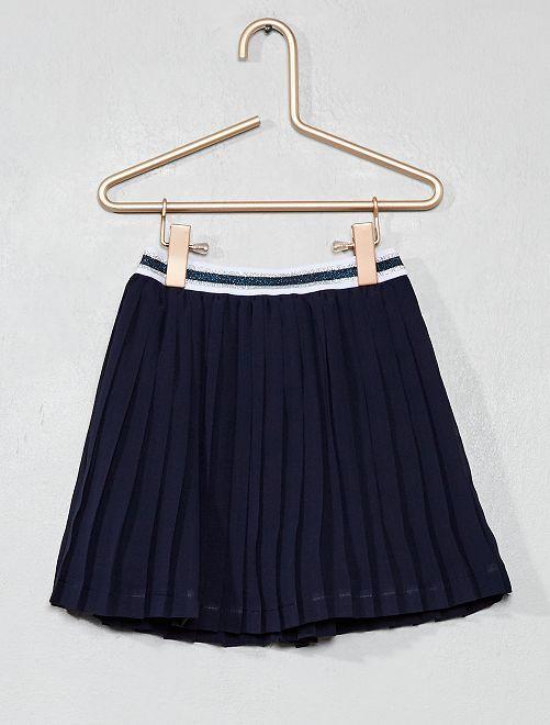 Falda corta plisada                                                                 azul marino Chica