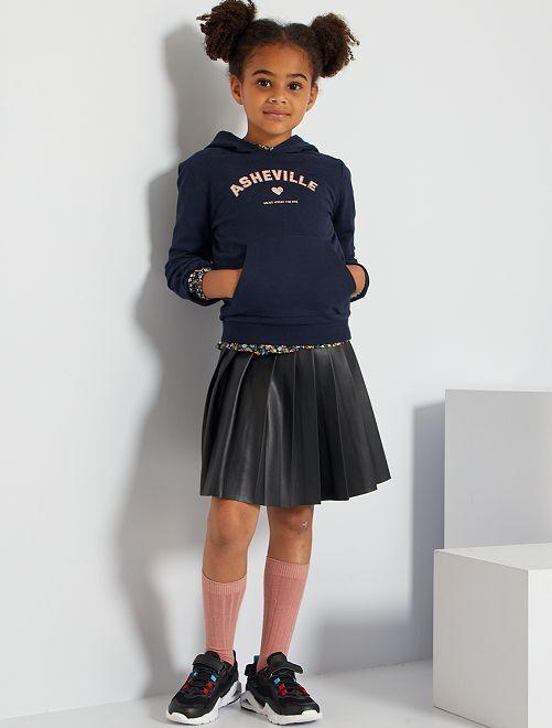 Falda corta plisada                             negro