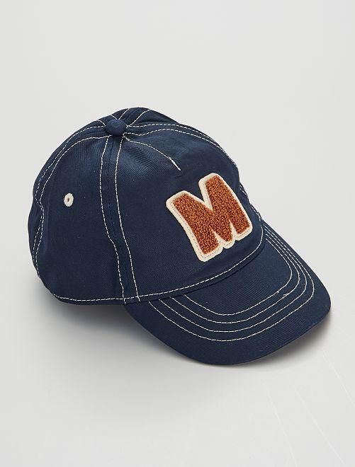 Gorra con letra de rizo                             azul