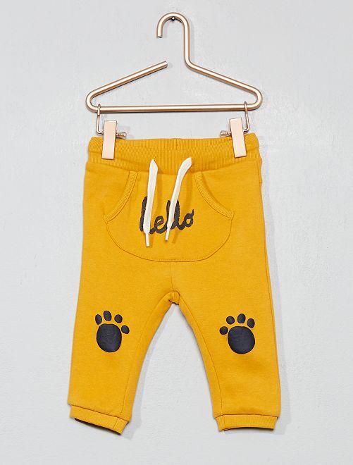 Pantalón con bolsillo estilo canguro de felpa estampado                                                                             AMARILLO Bebé niño