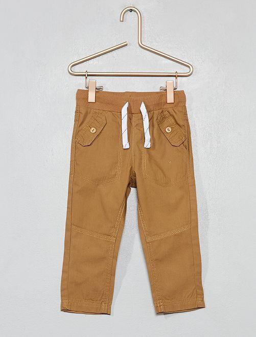 Pantalón con bolsillos abotonados                                                                 BEIGE Bebé niño