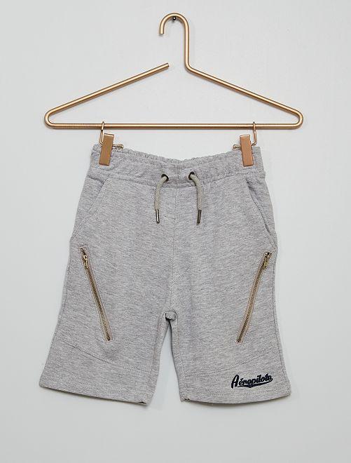 Pantalón corto de felpa cremallera                                                     gris