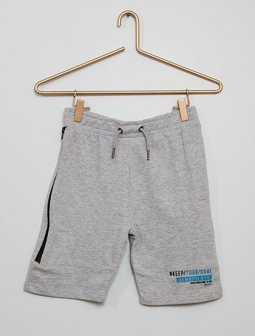 Pantalón corto felpa banda cremallera                                         gris