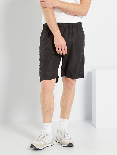Pantalón corto woven 'Umbro'                             NEGRO