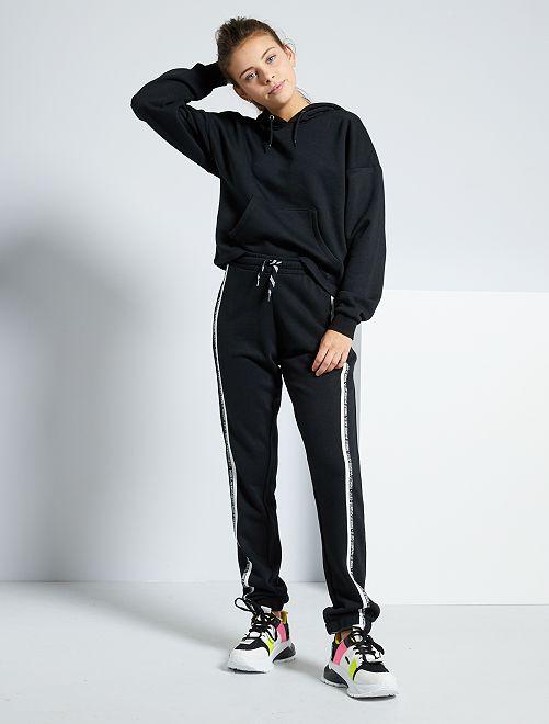 Pantalón de deporte con bandas laterales                                                     NEGRO