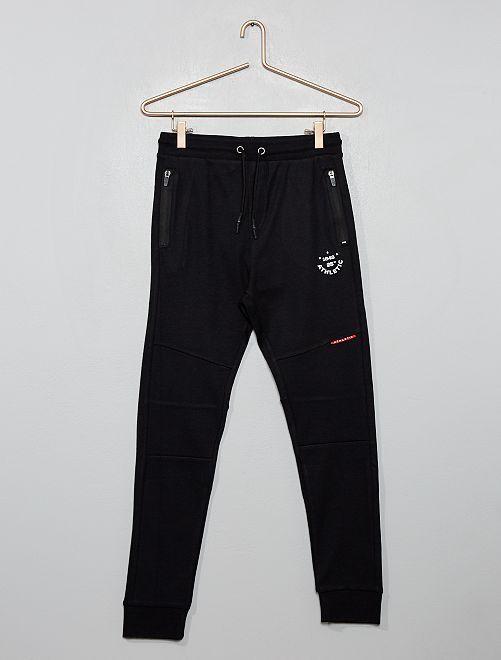 Pantalón de jogging con cremalleras en los bolsillos                                                     NEGRO