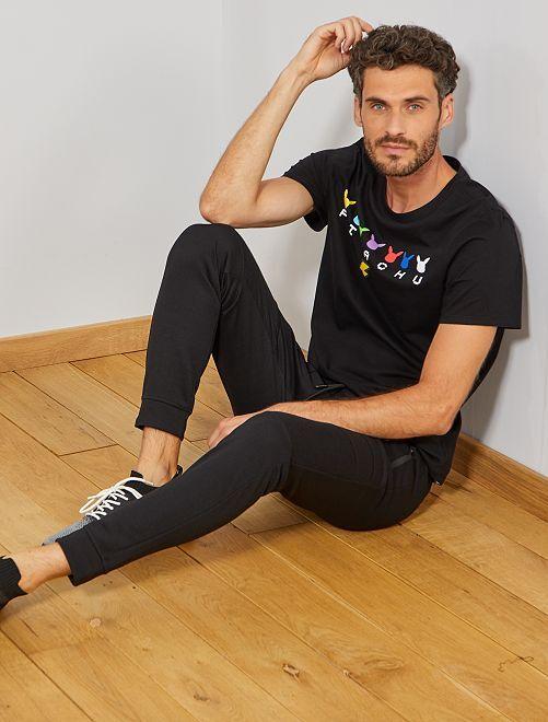 Pantalón deportivo con pespuntes                                                     negro