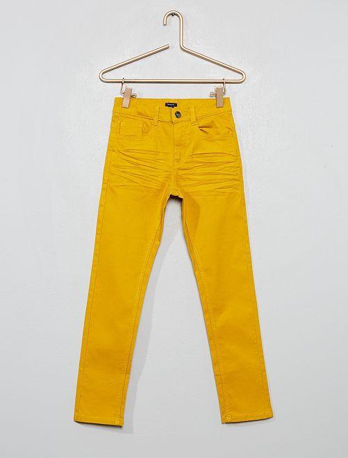 Pantalón skinny con cinco bolsillos                                                                                                                                                                 amarillo bronce