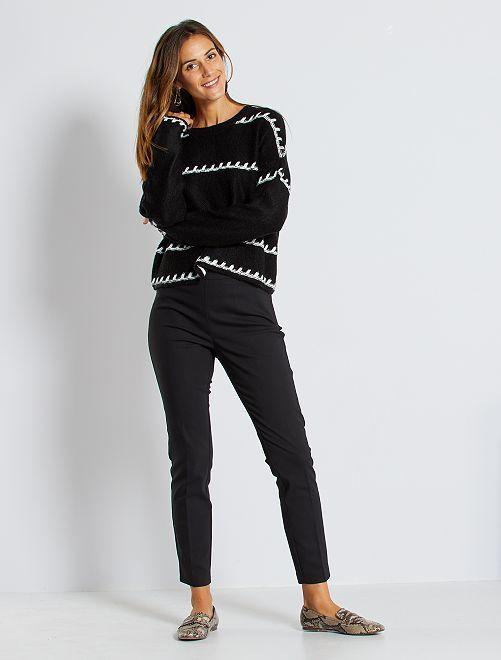 Pantalón skinny de talle alto                                                     negro