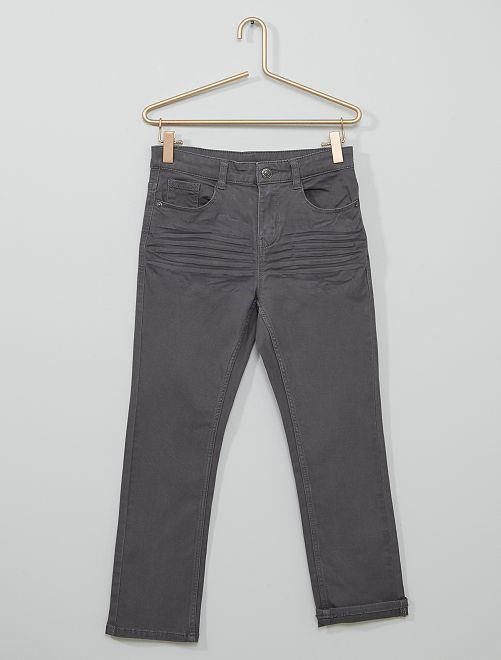 Pantalón super skinny elástico niño talla +                     GRIS
