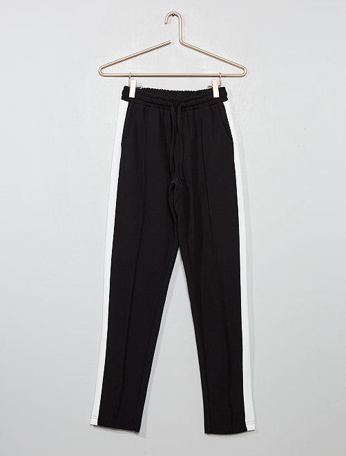 Pantalón vaporoso con franjas laterales blancas                                         negro