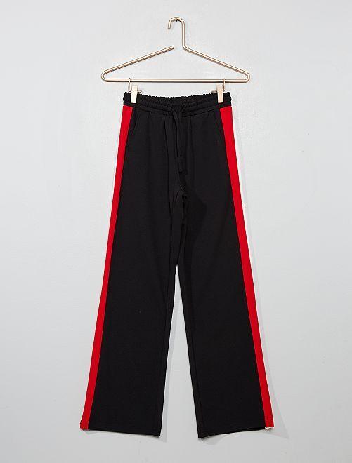 Pantalón vaporoso con franjas laterales                                         negro