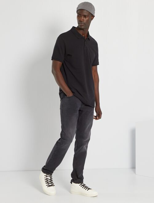 Polo liso regular                                                                                                                             negro