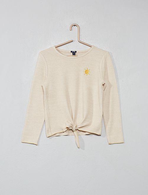 Un jersey muy suave con pespuntes en los acabados                             BEIGE Chica
